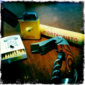 Matches, cigar Lighter, cigar and the ever trustworthy corkscrew.