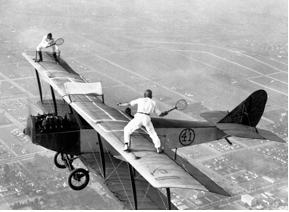 We've all had to put our game of biplane tennis on hold to wrestle a plane from a nosedive once or twice. But that's okay; it's in a gentleman's nature.