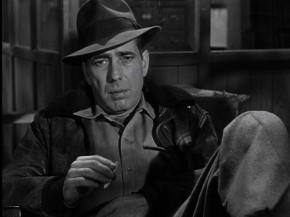 Humphrey Bogart is seen here during his 'Indiana Jones' period.  The hat maketh the gentleman.