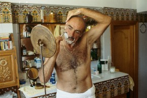 "Sean Connery must let his chest hair dry before donning a starched white shirt.  Notice his ""half nelson"" shaving technique."