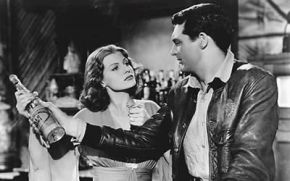 Here we see Cary Grant donning a leather jacket while admiring his newly-purchased bottle of liquor. When a gentleman wears leather, attractive women gravitate towards him, as illustrated here.
