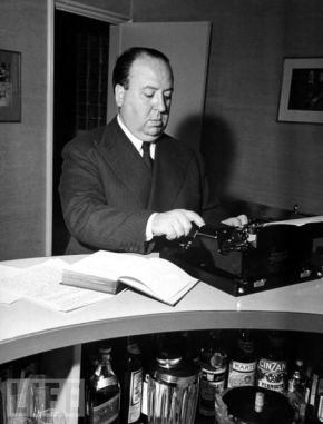 Alfred Hitchcock either working on a new film or compiling a list of his liquor.