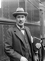 Howard Carter, who uncovered the tomb of Tutankhamun, is here seen with a bound version of The Gentleman Blog infront of the Gentleman's Vault.
