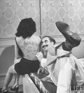 Groucho Marx writes the first 'text message' on this girls back.  She would then deliver the message and the recipient could send a message back to Groucho who would then have dinner with the message.
