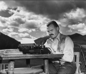 Hemingway sits in his office whilst typing up a question for The Gentleman.