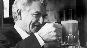 Former Australian Prime Minister Bob Hawke puts down his pint of Scotch and picks up his pint of beer.