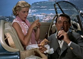 Cary Grant and Grace Kelly missed their opportunity to picnic in spring and have to opt instead for a bue screen projection of spring.