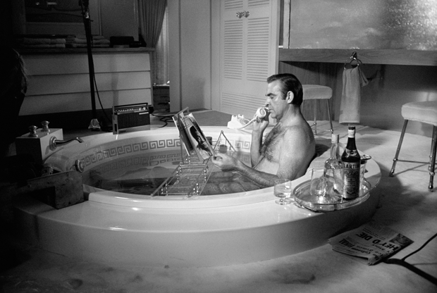 Busy at the office, here we see Sean Connery calling his secretary to pencil in some much needed respite.
