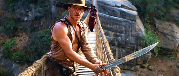 Harrison Ford conducts a safety inspection on this rickety jungle bridge.